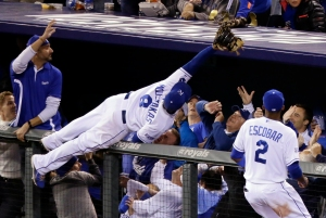 Kansas City Royals third baseman Mike Moustakas makes a catch on a ball hit by Baltimore Orioles' Adam Jones during the sixth inning of Game 3 of the American League baseball championship series Tuesday, Oct. 14, 2014, in Kansas City, Mo. (AP Photo/Michael Conroy)